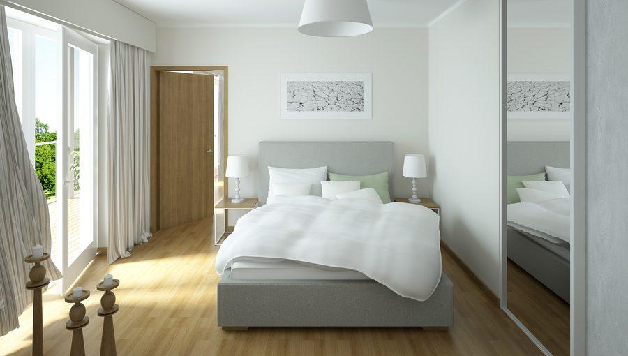 Łóżko w sypialni po szafie