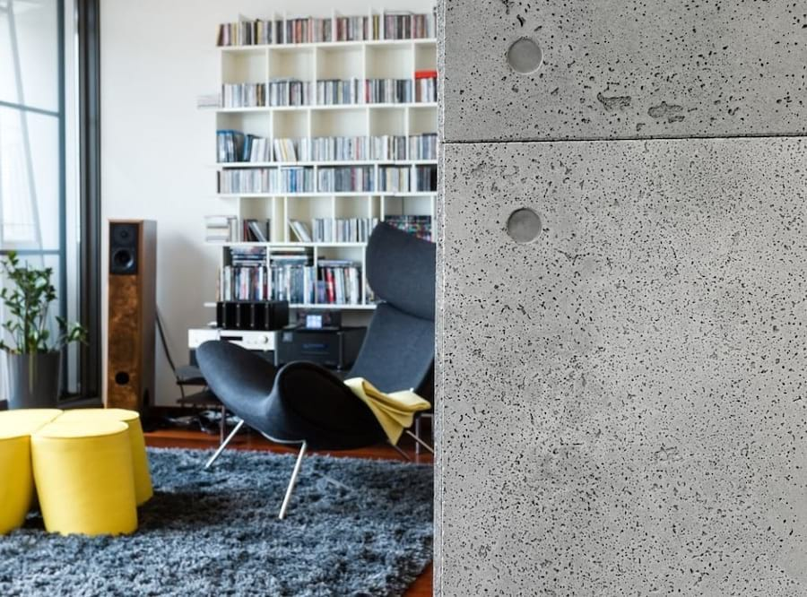 Wnętrze wykończone z użyciem płyt betonowych Contractors