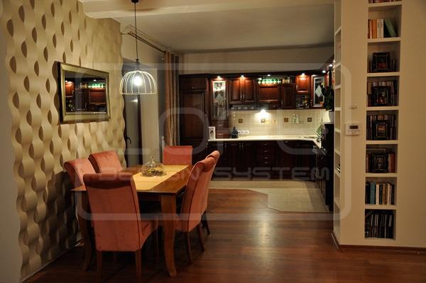 Ściany dekoracyjne z płyt gipsowych wykorzystane do wyznaczenia stref użytkowych w mieszkaniu.