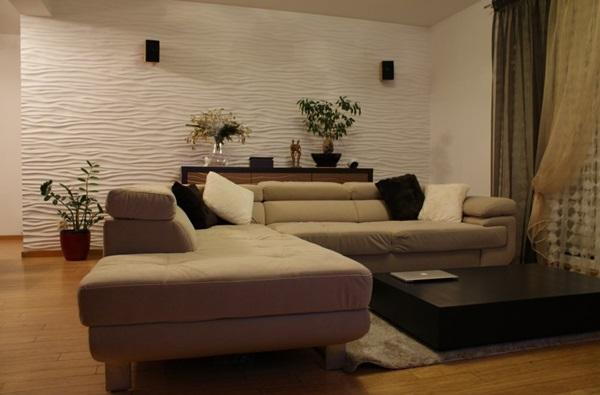 Płyty gipsowe dekoracyjne wykorzystane do ozdobienia ściany w salonie.