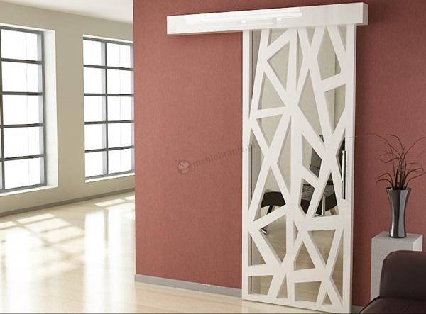 Panel ażurowy mdf mouk wykorzystany jako przesuwane drzwi.