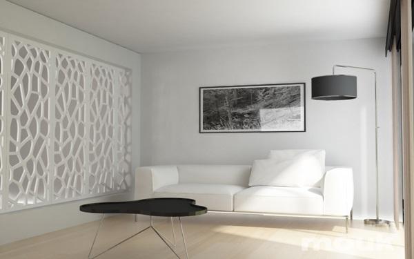 Panele ażurowe mdf mouk tworzące ściankę działową w salonie.