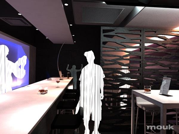 Ścianka działowa w klubie stworzona z paneli ażurowych mouk.
