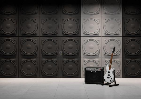 Pokój młodzieżowy ze ścianą ozdobioną panelami gipsowymi 3D w kształcie głośników.