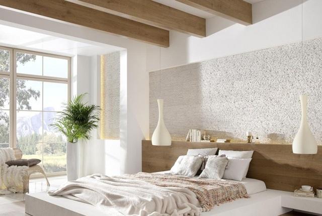 Ściana nad łóżkiem wykończona kamieniem Incana Sierra Arctic