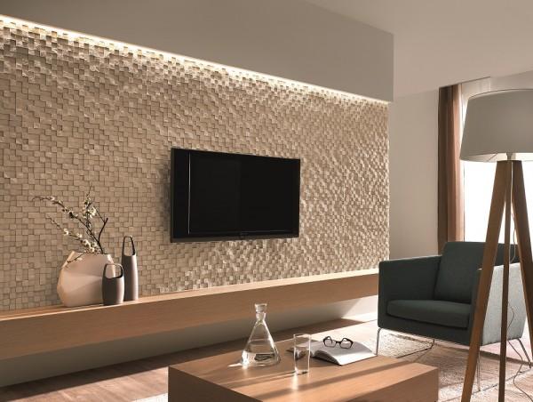Kamień na ścianie w salonie Qubo Frost Incana Decor wykorzystany jako tło dla tv.