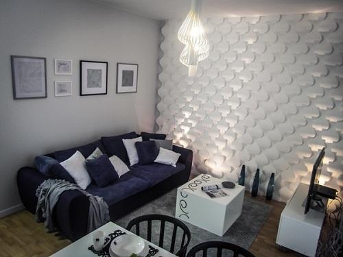 Panele 3d na ścianę wykorzystane w przytulnym w salonie.