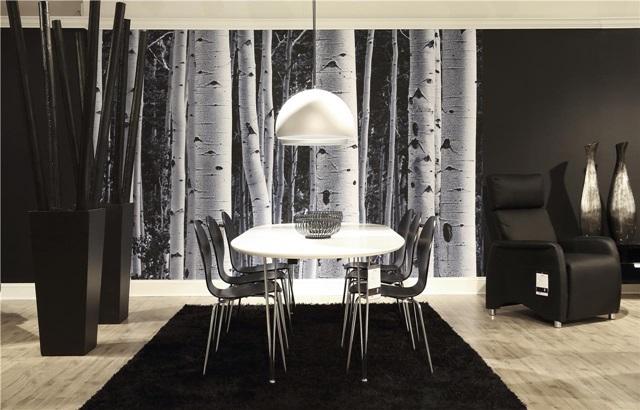 Styl skandynawski z ciemnymi meblami Actona, rozproszony jedynie białym stołem.