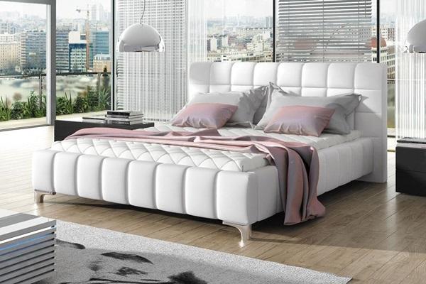 Łóżko z pikowanym zagłówkiem, białe.