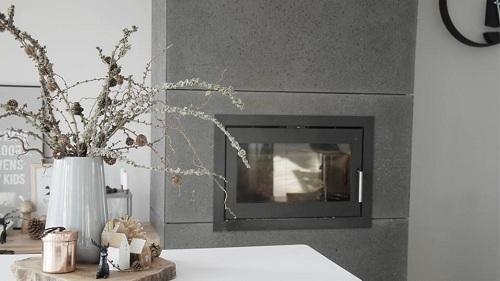 Styl skandynawski we wnętrzu wykończonym płytami z betonu architektonicznego