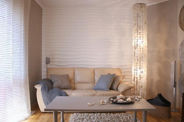 Panel dekoracyjny na ścianę wykorzystany jako tło dla sofy